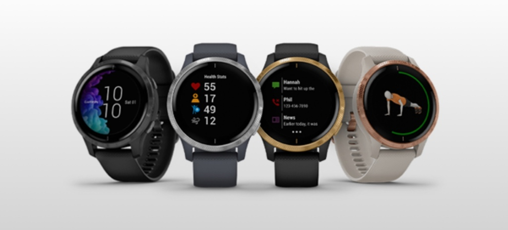 Four Garmin Venu Smartwatches lined up next to each other.